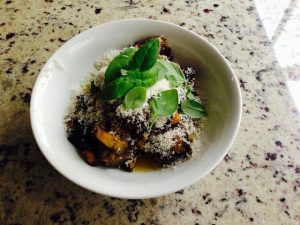 Roasted Eggplant topped with parmesan, cracked pepper and fresh basil