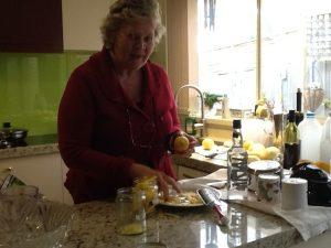Peeling lemons with a potato peeler