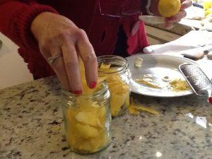 Filling the jars with lemon skin