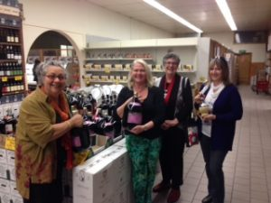Amore Cucina guide Agata Commisso and class participants shopping for wine